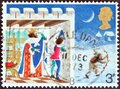 UNITED KINGDOM - CIRCA 1973: A stamp shows Page looking out of window, Illustration for Christmas carol Good king Wenceslas.