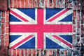 United kingdom flag of on the old brick window Stock Photos