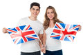 United kingdom supporters with flags proud young couple holding british flag Stock Image