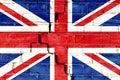 United Kingdom UK flag painted on cracked brick wall. Royalty Free Stock Photo