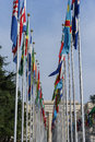 United nations in geneva view of the entrance to palace of and the gallery of the national flags switzerland photo taken Stock Photo