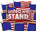 United we stand american flags usa unity motto together words of solidarity and on or waving in patriotic pride as a symbol of Stock Images