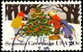 A stamp printed in UNITED STATES OF AMERICA shows Kids Making A Snowman with inscription