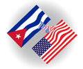 United States of America and Cuba flags shaking hands, contemporary and future cooperation and teamwork Royalty Free Stock Photo