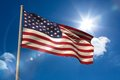 United states of america national flag on flagpole blue sky background Royalty Free Stock Image