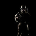 United states army ranger with assault rifle on dark background Royalty Free Stock Image