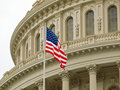 United States Capitol Building with American Flag Royalty Free Stock Photo