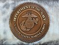 United States Department Of The Navy Marines Corps Coin in a Concrete Slab Royalty Free Stock Photo