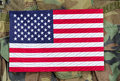 United States flag with military background Royalty Free Stock Photo