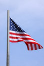 United states flag over blue sky Stock Photos