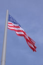 United states flag over blue sky Stock Photo