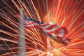 United states flag over fireworks on flagpole Royalty Free Stock Image
