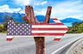 United States Flag wooden sign with a road background Royalty Free Stock Photo