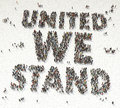United we stay text written out of people aerial view Royalty Free Stock Photo