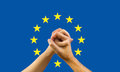 Unity in europe a woman and a man his hands with a flag of background concept of Stock Photo