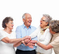 Unity - Old people team working together Stock Image