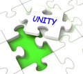 Unity puzzle shows partner team teamwork or collaboration showing Royalty Free Stock Photography