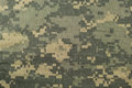 Universal camouflage pattern, army combat uniform digital camo, USA military ACU macro closeup, detailed large rip-stop fabric Royalty Free Stock Photo