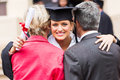 University graduate parents gorgeous female hugging her after graduation Royalty Free Stock Photos