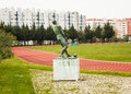 University stadium lisbon portugal field n and the monument to the hammer thrower in of in it is a statue in bronze from by Royalty Free Stock Images