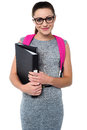 University student ready to attend college girl posing with backpack and files Royalty Free Stock Image