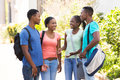 University students chatting happy afro american outdoors Royalty Free Stock Image