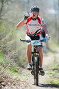 Unknown bike racer galati romania april on the competition of the mountain xc garboavele on april in galati romania Royalty Free Stock Photos