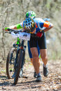 Unknown racer galati romania april on the competition of the mountain bike xc garboavele on april in galati romania Royalty Free Stock Images