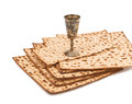 Unleavened bread matzoth for jewish passover traditional food matzoh special and wine cup isolated on white Royalty Free Stock Images