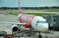 Unloading of baggage from the Air Asia aircraft Royalty Free Stock Photo