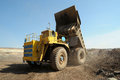 Unloading truck in a career of iron ore Stock Photography