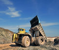 Unloading truck in a career of iron ore Royalty Free Stock Image