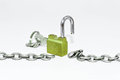 Unlocked chain with padlock in a white background Royalty Free Stock Image