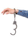 Unlocked handcuffs on a hand hanging isolated the white background Royalty Free Stock Photos