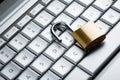 Unlocked padlock on laptop keyboard close up Royalty Free Stock Image