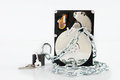 Unlocked padlock near of chained hard disk drive concept free information Royalty Free Stock Photography