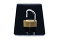 Unlocked padlock on a tablet computer isolated white background concept photo of technology mobile and security Royalty Free Stock Photos