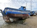 Unloved boat a derelict aground in the marshes of the ria formosa portugal Stock Photography
