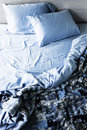 Unmade bed and bedding Royalty Free Stock Photo