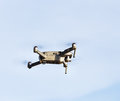 Unmanned aerial vehical with video camera hovers in the air. Thi