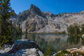 An unnamed peak over the lower of twin lakes in the sawtooth mountains a picture near alice lake even though it is august there Royalty Free Stock Photo