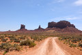 Unpaved dirt road leads monument valley utah usa Stock Photography