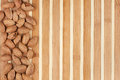 Unpeeled almonds lying on a bamboo mat Royalty Free Stock Photography