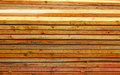 Unplaned thick planks covered with antiseptic preparation Royalty Free Stock Photos