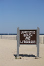 Unprotected Beach Sign No Lifeguards Stock Images
