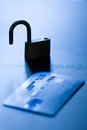 Unprotected credit card monochromatic shallow depth of field shot featuring silhouette of an unlocked padlock close to a concept Stock Photo