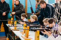 Unrecognizable belarusian secondary school pupils girls shooting gomel belarus january an air rifle at a sports competition Royalty Free Stock Photos