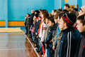 Unrecognizable belarusian secondary school pupils lined up in th gomel belarus january the gym before the winter ski Royalty Free Stock Image