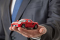 Unrecognizable businessman showing a toy car Royalty Free Stock Photo