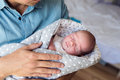 Unrecognizable father holding newborn baby son in his arms Royalty Free Stock Photo